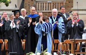 Carol Folt acknowledges the crowd's cheers during the ceremony installing her as Carolina's 11th chancellor.