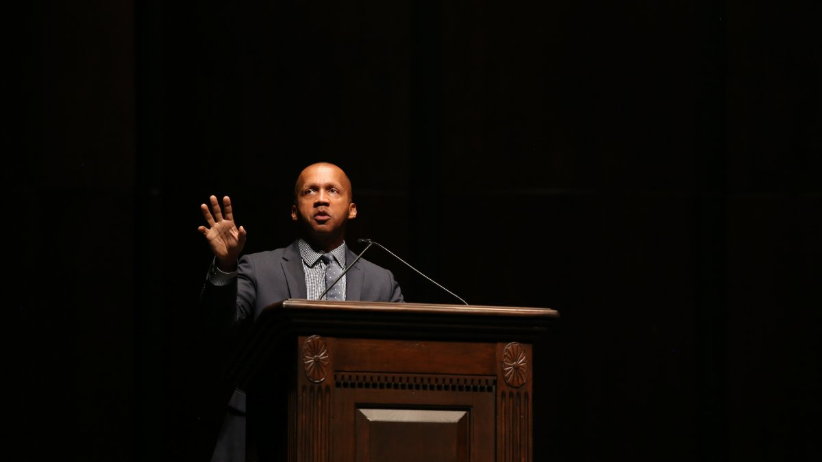 Lawyer and author Bryan Stevenson delivers his message on stage at Memorial Hall