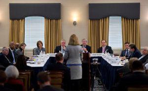 Julien Byerley speaks surrounded by the Board of Trustees.