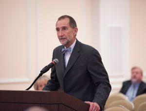 Dean Bill Roper speaks at podium.