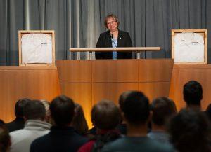 Dean Jane Weintraub presents the two framed jackets.