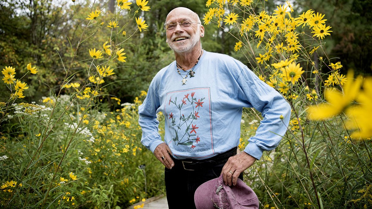 Ken Moore stands in the Botanical Gardens.