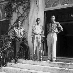 Leroy Frasier, John Lewis Brandon and Ralph Frasier stand on the steps of South Building
