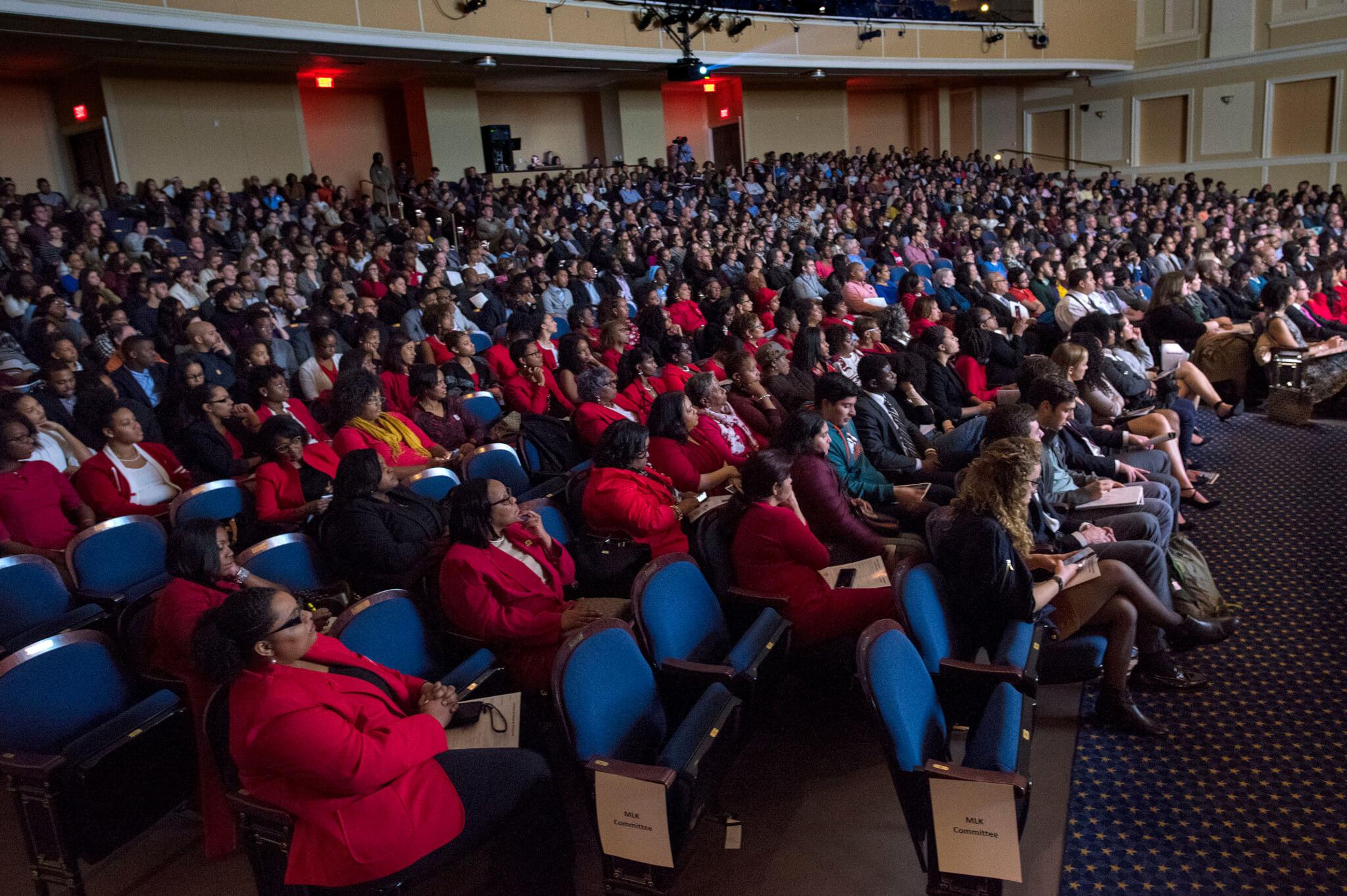 Crowd listens to speaker