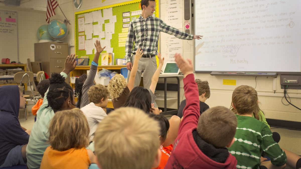 Male student teaching in an elementary classroom.