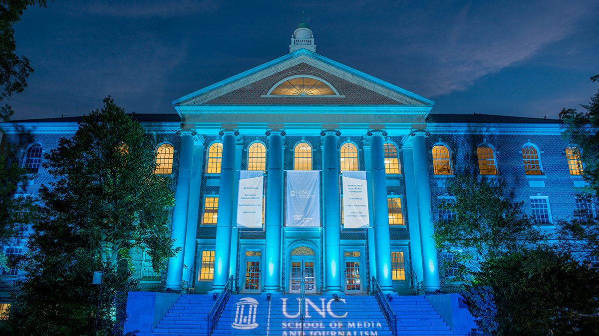 Carroll Hall lit up at night to celebrate change to school's name -- School of Media and Journalism.