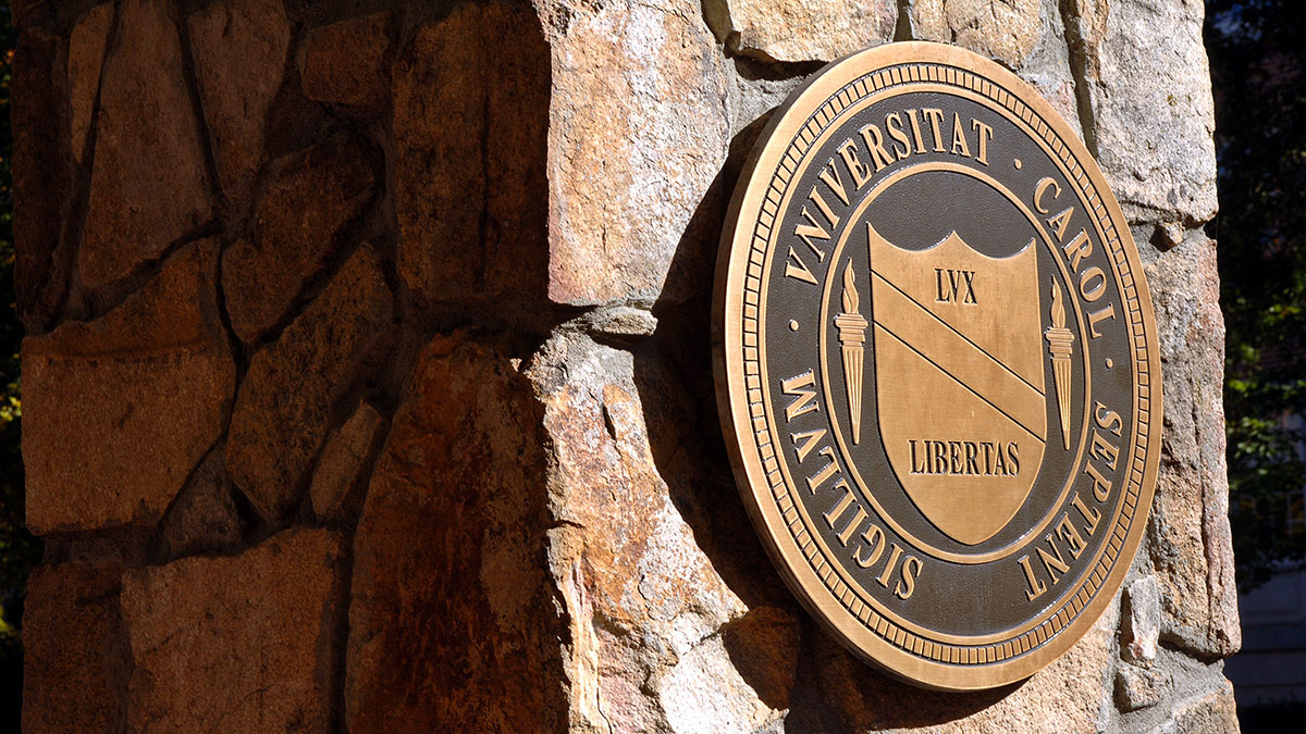 The UNC-Chapel Hill seal on a stone wall.