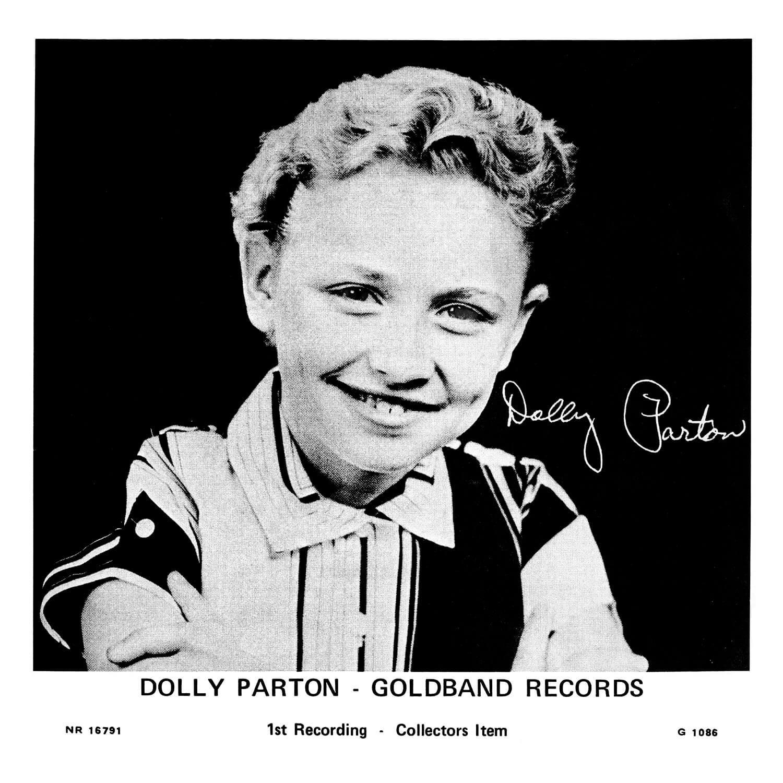 A young Dolly smiles at camera.