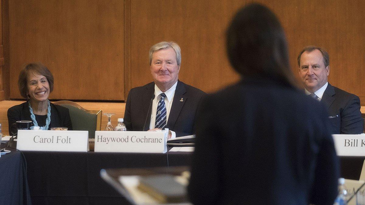 Board of Trustees listen to speaker.