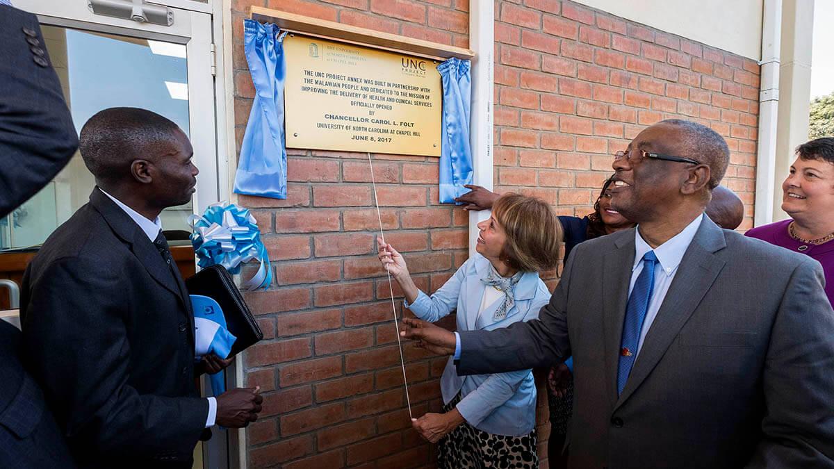 Chancellor Carol Folt unveils a plaque
