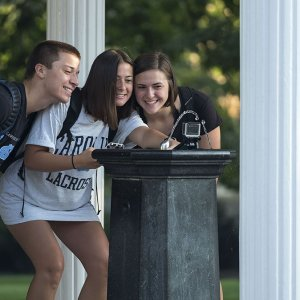 Students drink from the Old Well.