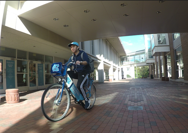 Student on a bike.