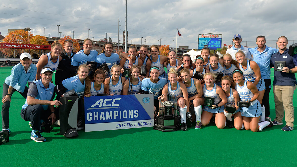 Field hockey team poses for a photo.
