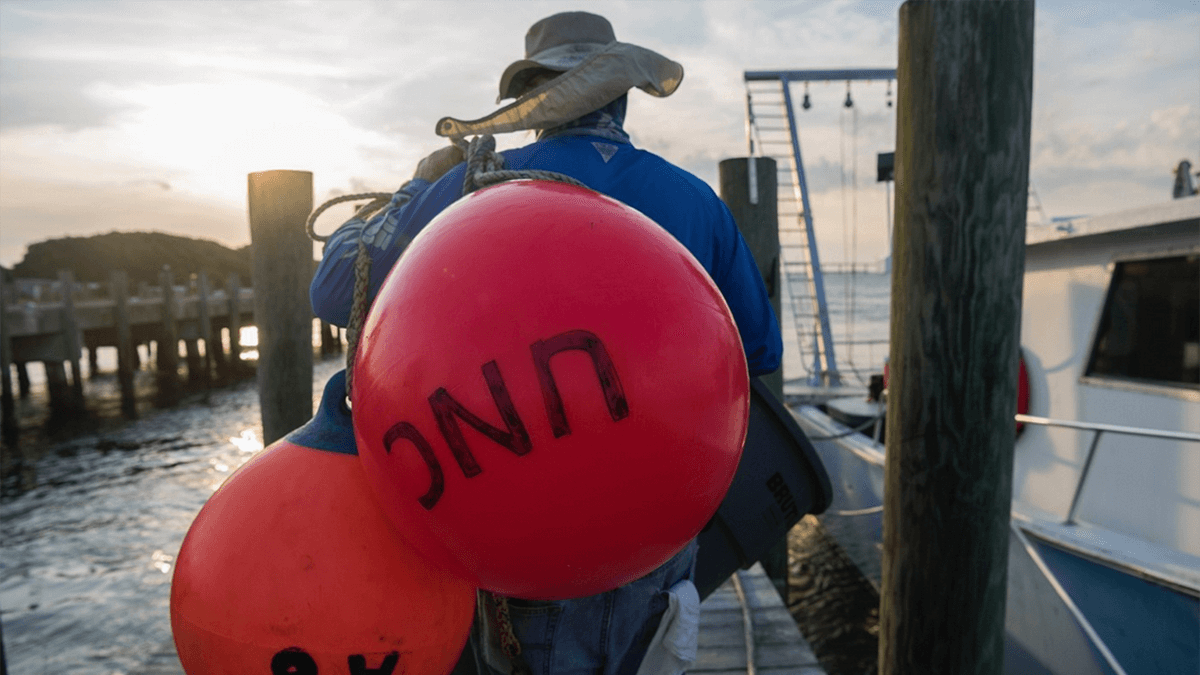 Claude Lewis carries buoys