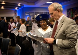 Betsy Noelle and Terry Magnuson hold a program for the MLK banquet and stand and sing
