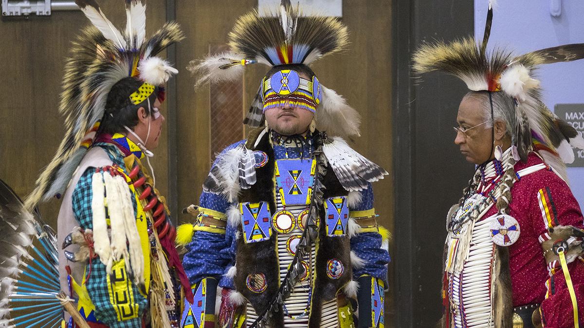 Powwow dancers prepare to perform.