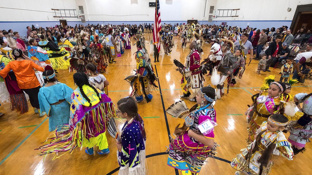 Powwow dancers perform.