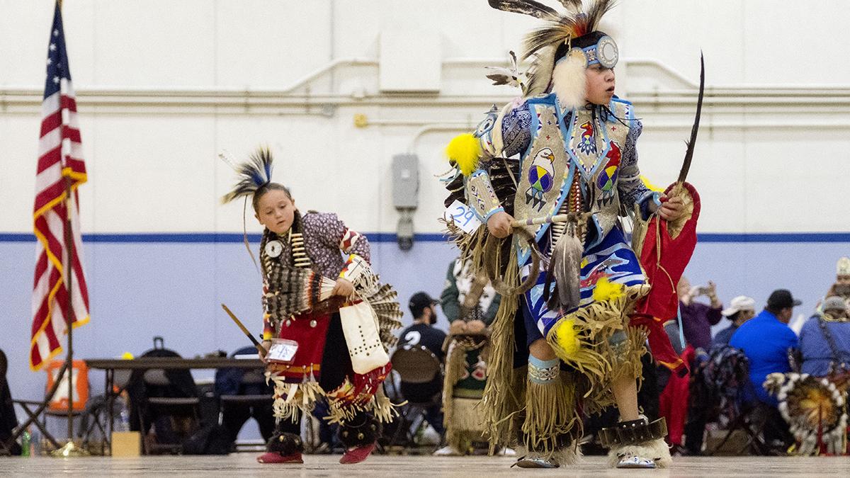 Powwow dancers perform