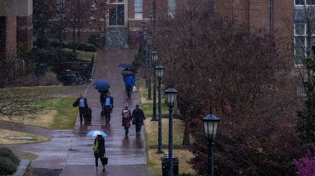 Students outside in an early spring snow.