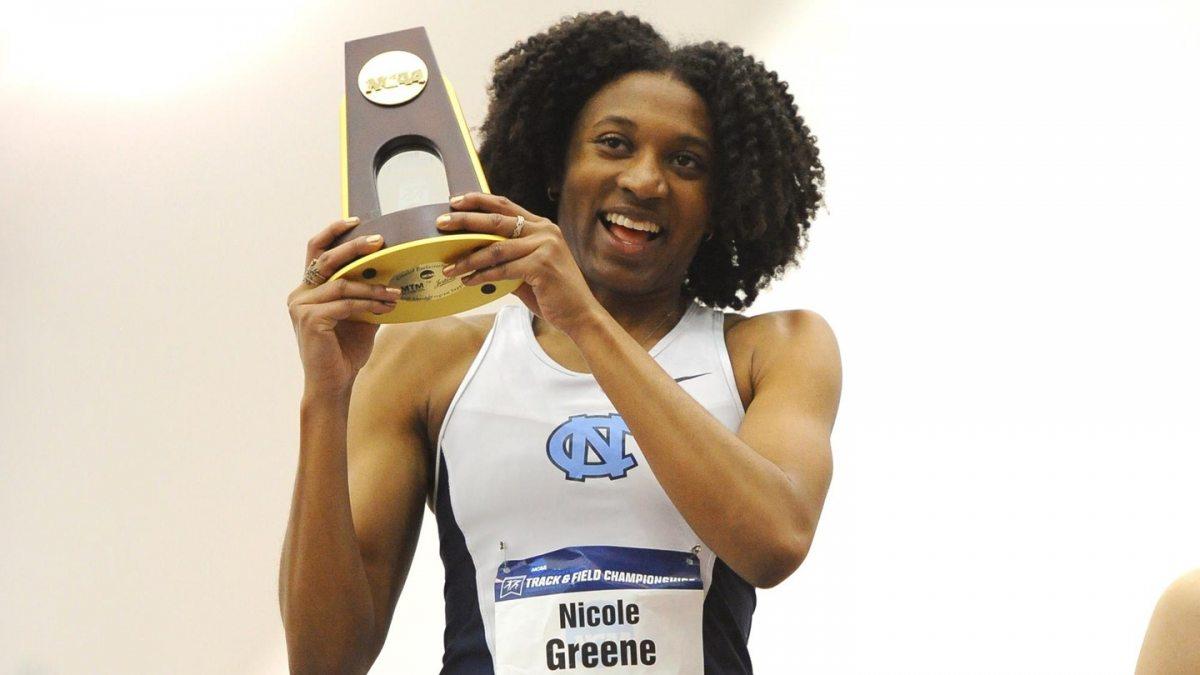 Nicole Greene hoists her championship trophy.