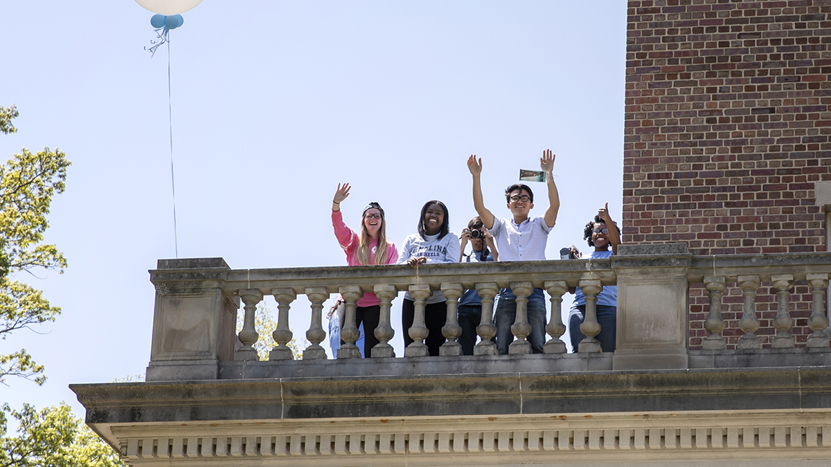 Students wave from the Bell Tower.