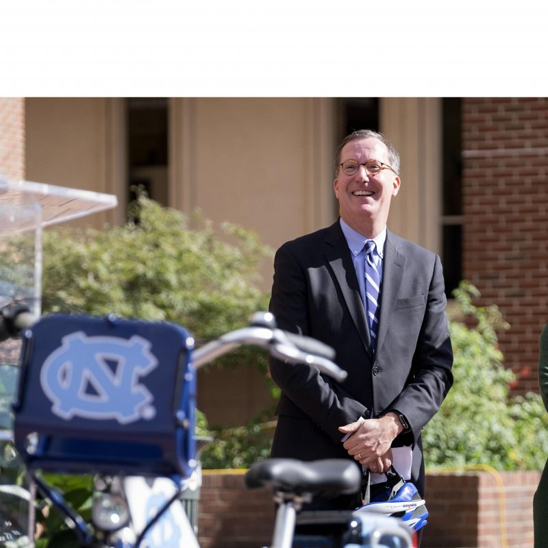 Brad Ives stands next to a bike.
