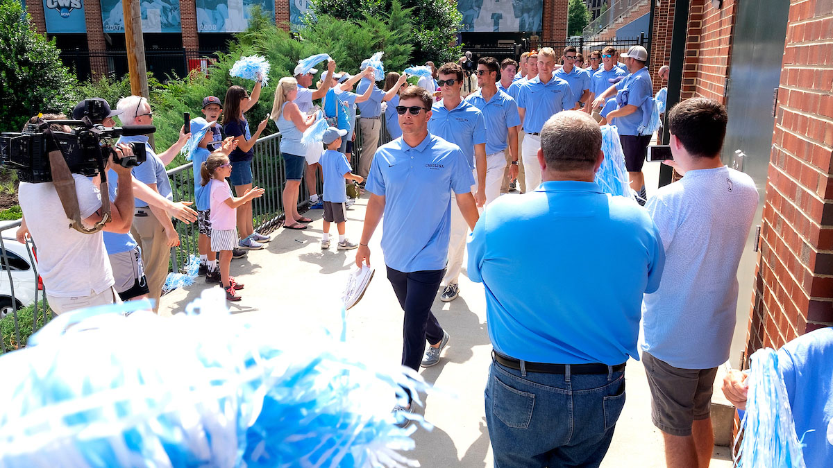 The Carolina baseball team walks to the bus.