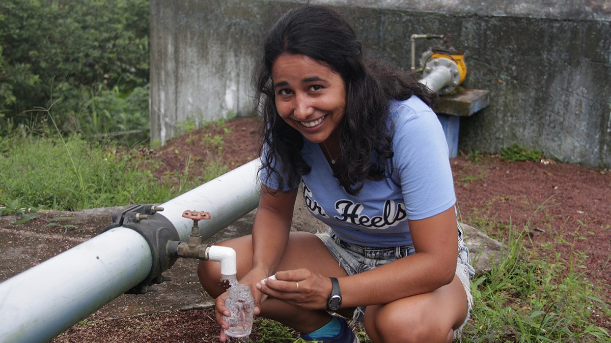 Daira Melendez fills a bottle of water in the Galapagos.
