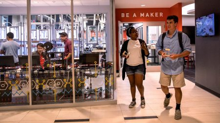 Students walk in the Makerspace.