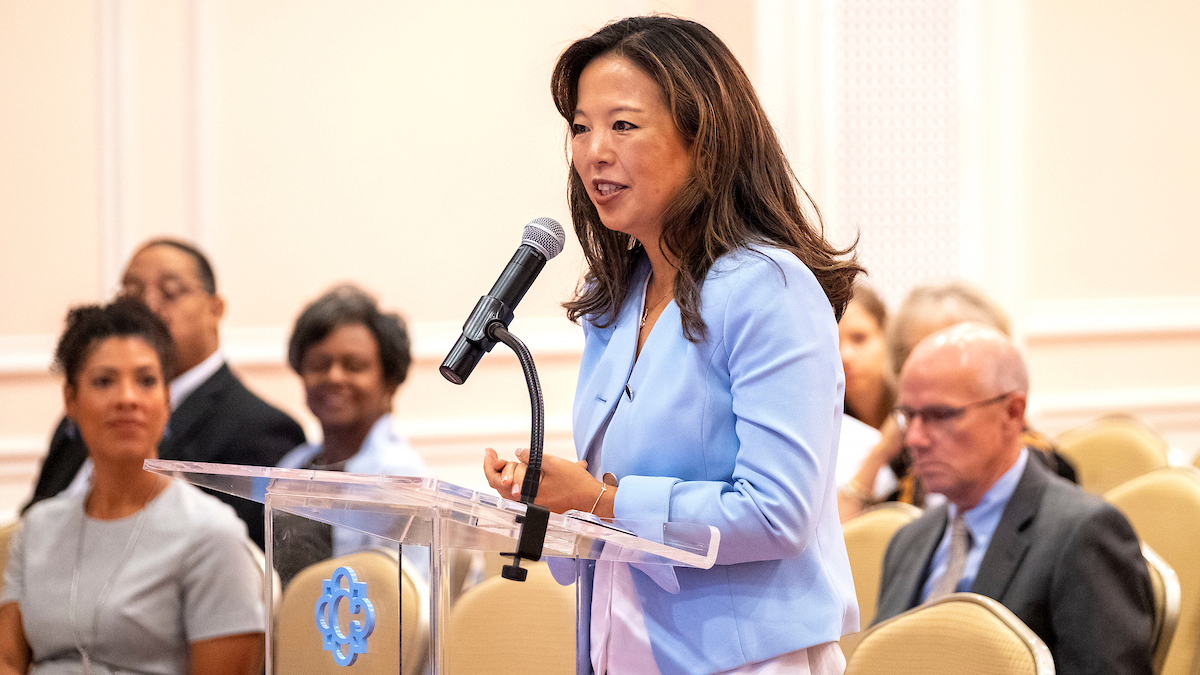 Jessica Lee speaks at podium