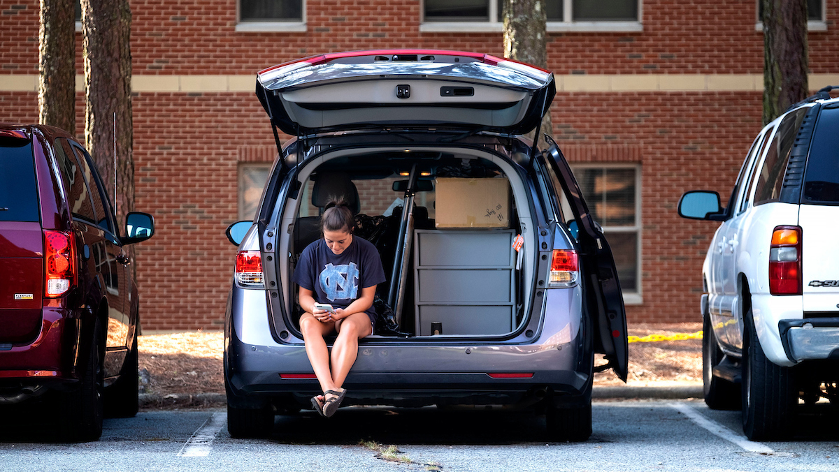 A woman sits in a mini van.