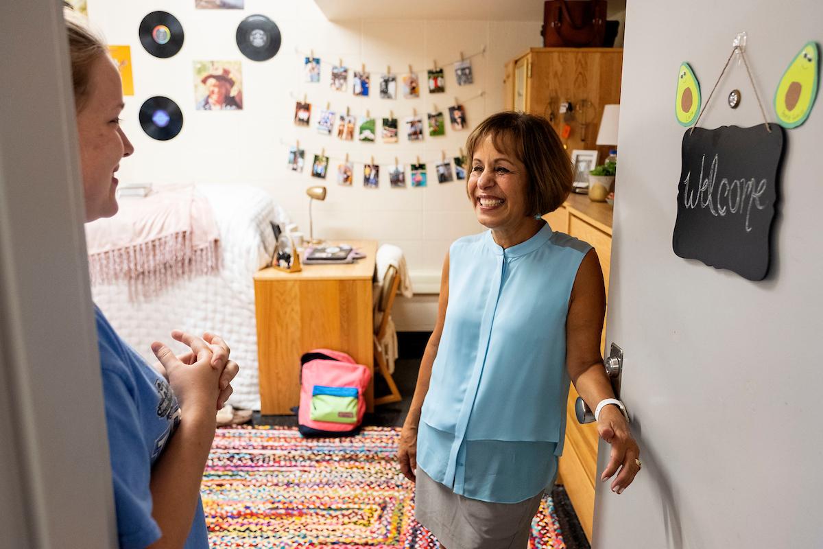 Chancellor Carol L. Folt talks with a student.