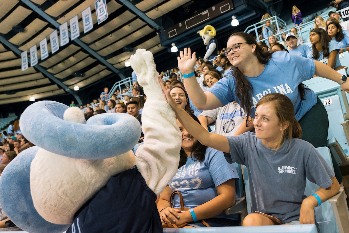 Students high-five the Rameses Jr. mascot