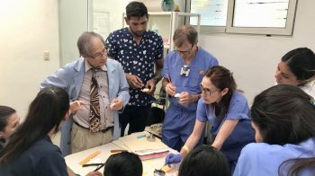 Dentists give students a demonstration