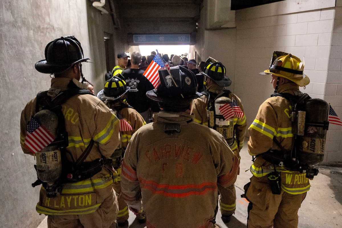 Firefighters stand in a tunnel at Kenan Stadium.
