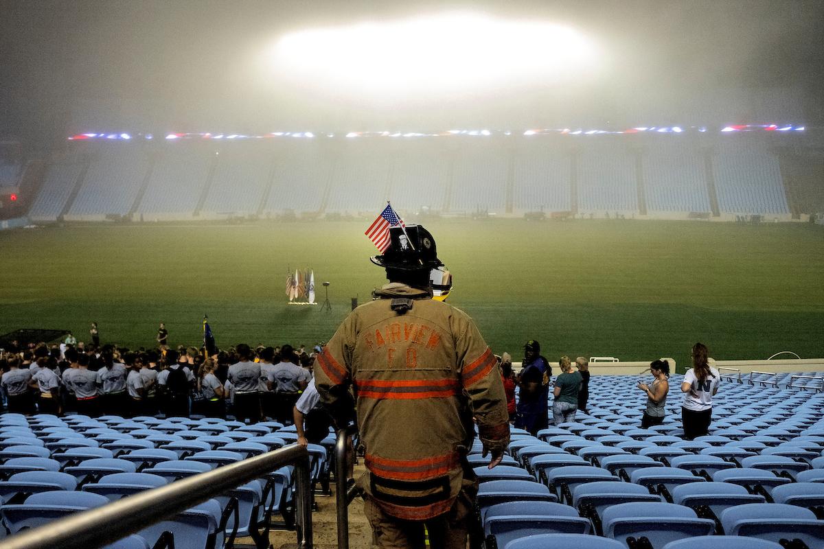 A firefighter walks down steps at Kenan Stadium.