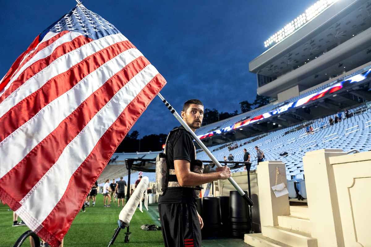 A man holds an American flag.