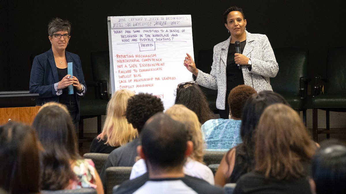 Becci Menghini, senior associate vice chancellor for Workforce Strategy, Equity and Engagement, and Gretchen C. Bellamy, senior director, education, operations and initiatives, for Diversity and Inclusion, at the Pleasants room in Wilson Library.