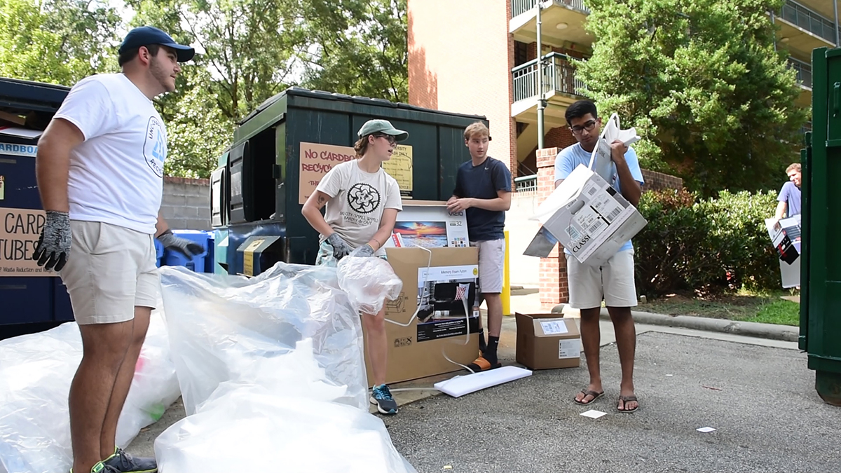 Students recycle cardboard.
