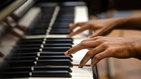 A man plays piano.