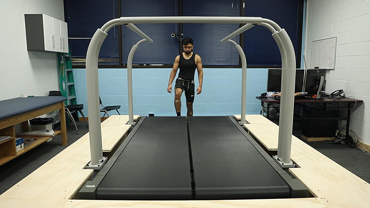 A man walks onto a treadmill.