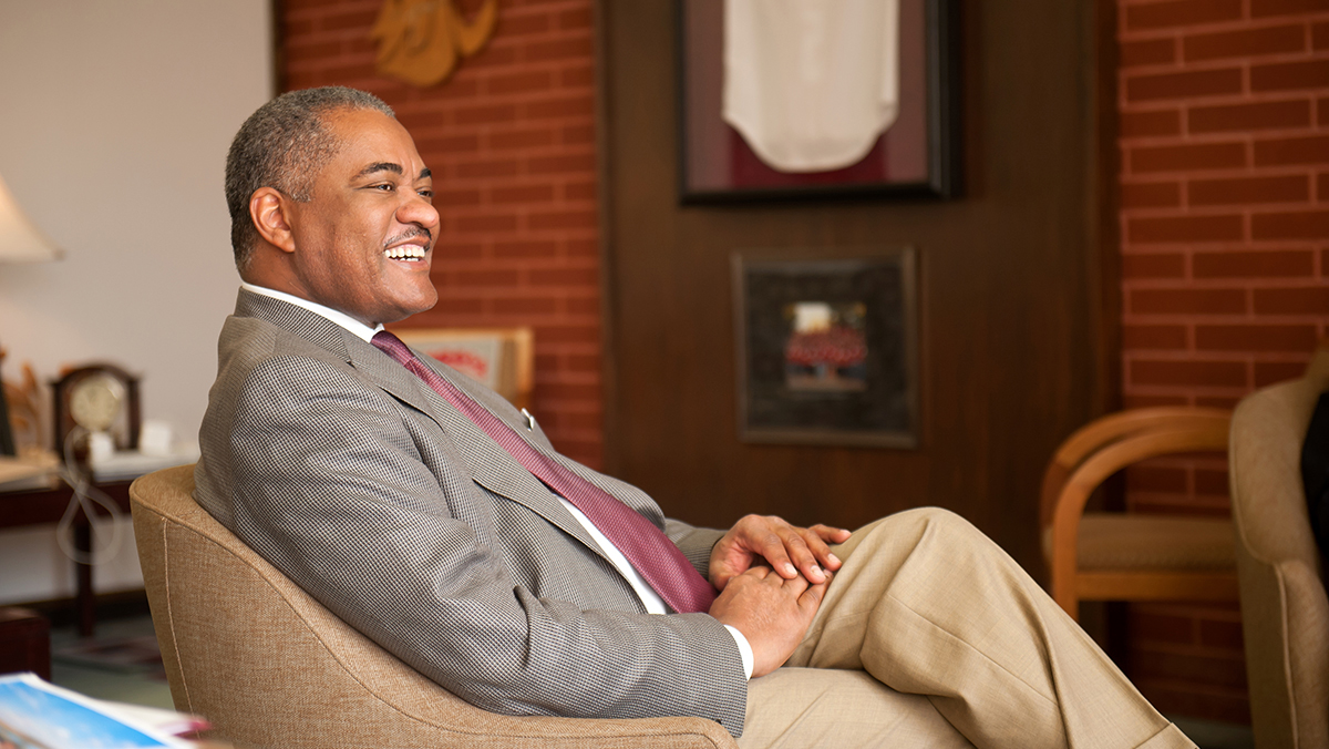 Elson S. Floyd sitting in a chair.