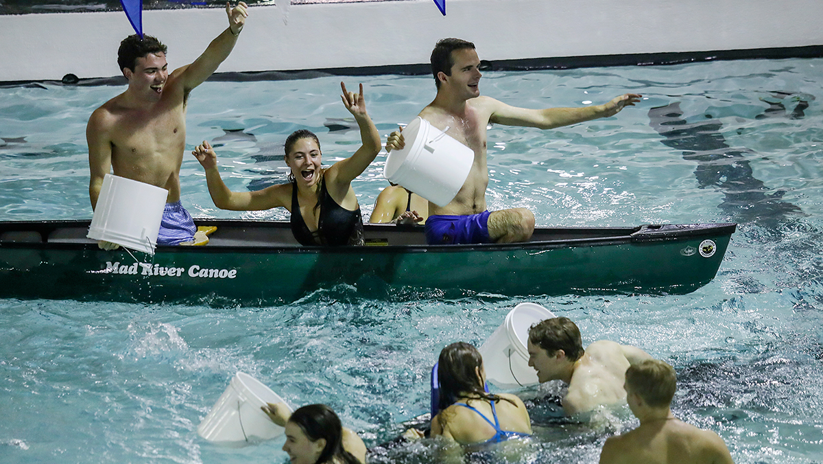 A canoe sinks in the Bowman Gray Pool during a battleship tournament.