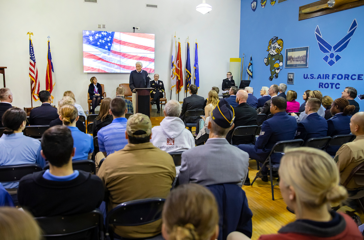 Community members gather at the ROTC Armory for a Veterans Day ceremony.