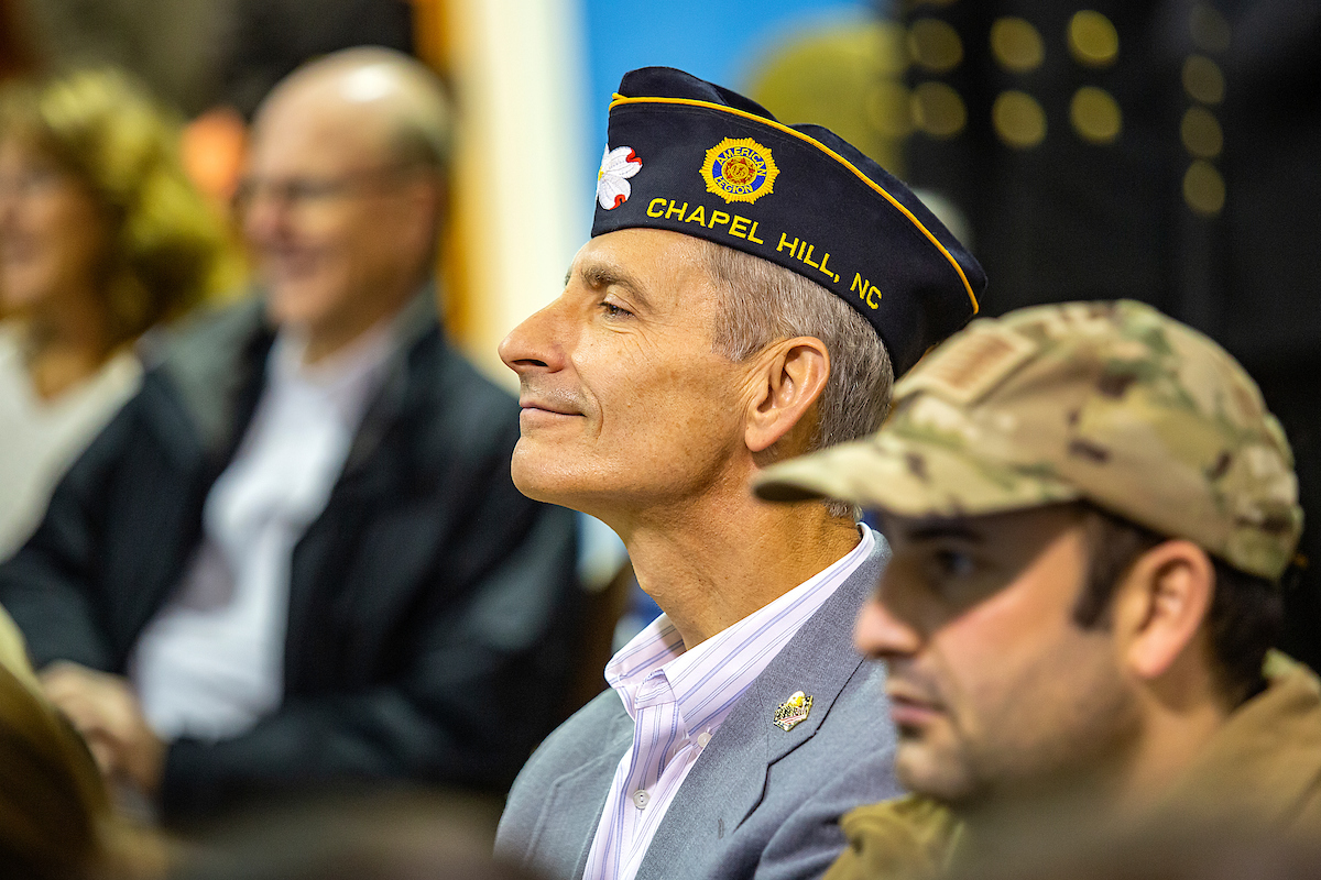 An audience member listens during the ROTC Veterans Day ceremony.