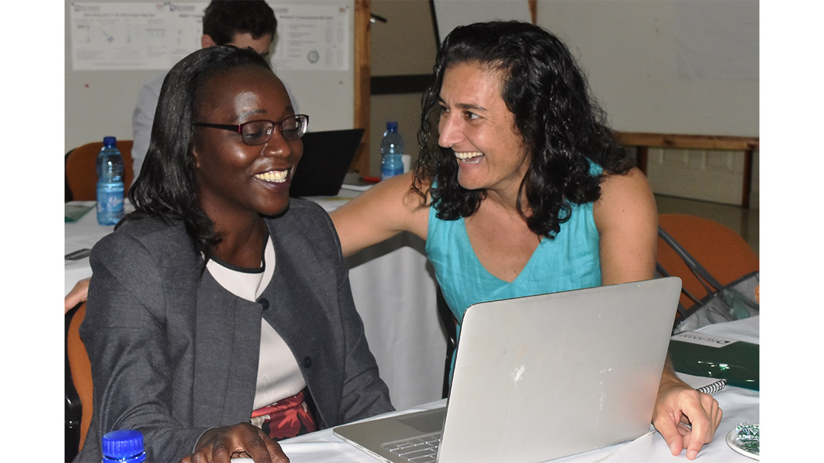 Mina Hosseinipour talks with Cecilia Kanyama, lead of the AIDS Clinical Trials Group and an internal medicine physician with UNC-Project Malawi, at a recent scientific workshop.