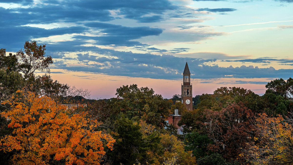 An overall photo of the UNC-Chapel Hill campus at sunset.