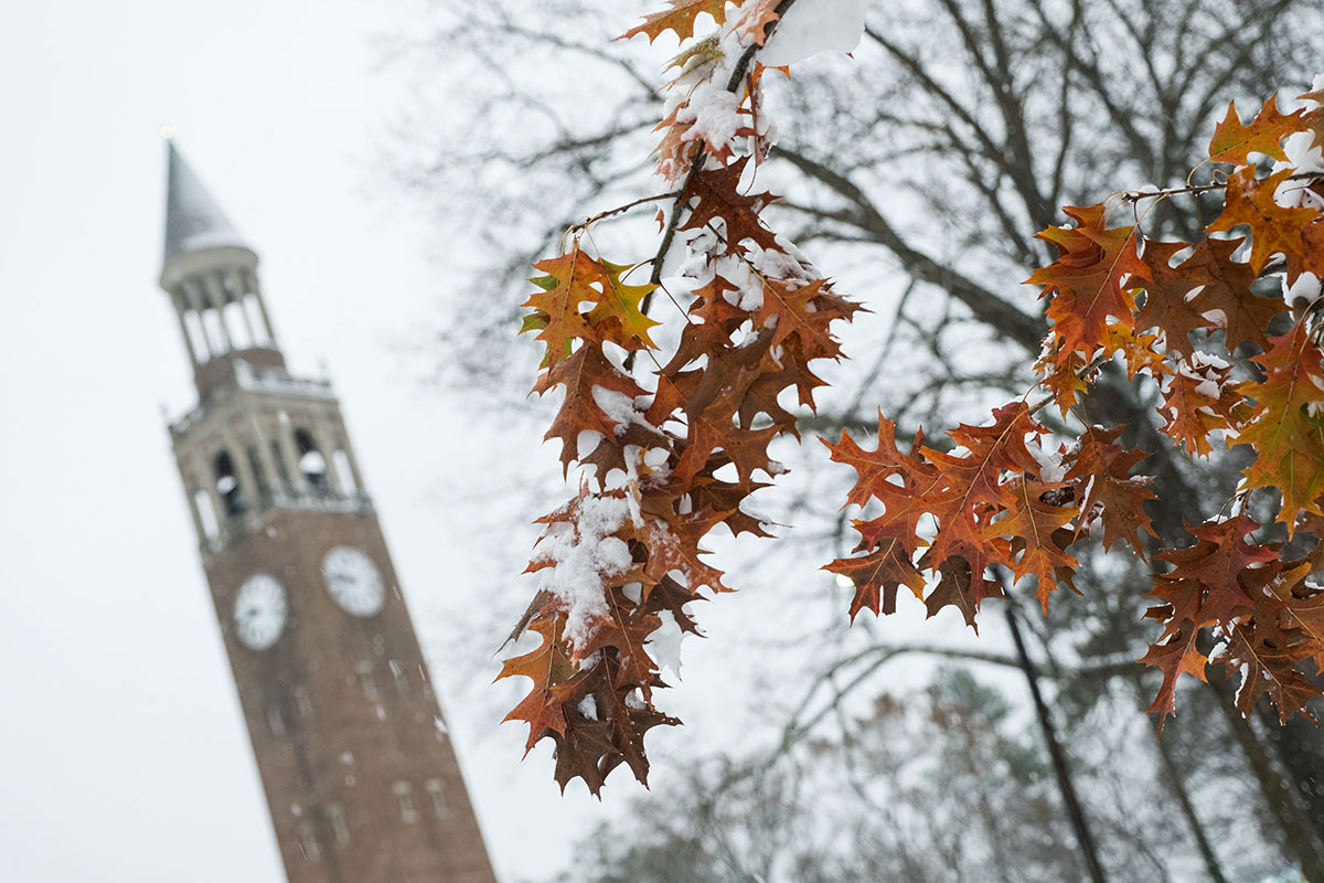 Snow falls on the bell tower