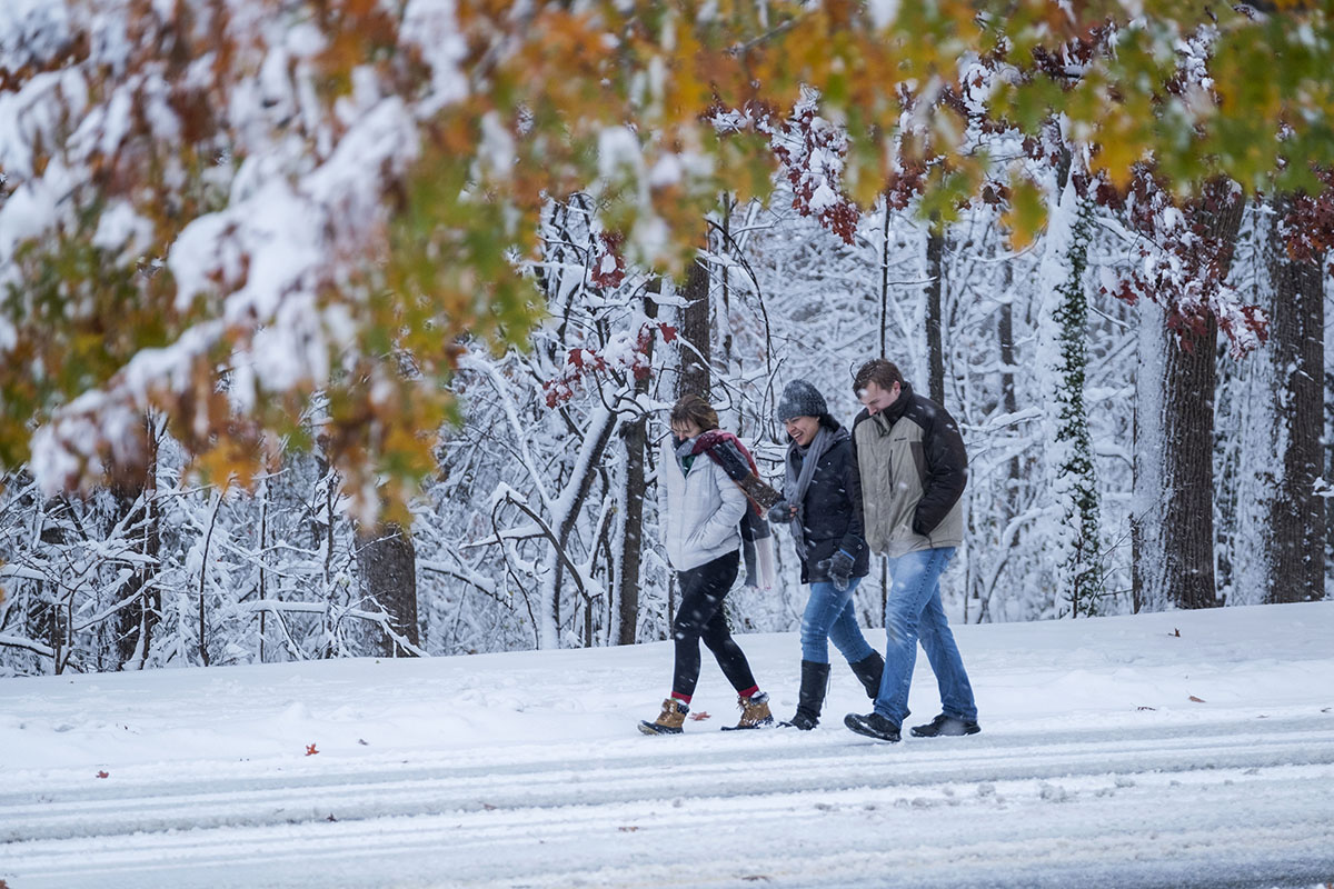Students walk in the snow.