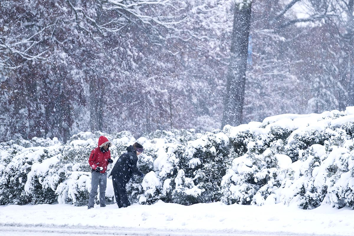 Students walk in the snow